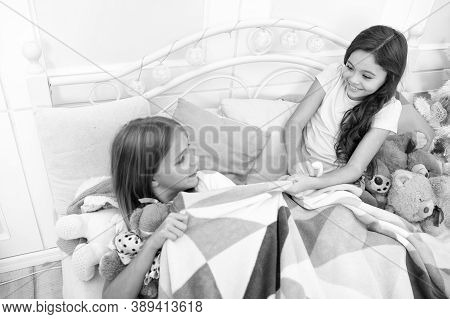 Naughty Girls. Small Girls Fight Over Blanket. Little Girls Have Fun Together. Happy Girls Being Noi