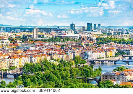 Prague Skyline With Bridges Over Vltava River And Modern Skyscrapers Of Pankrac District On Bankgrou