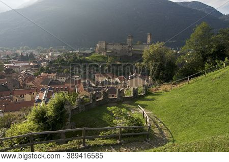 View Over Bellinzona Town And The Beautiful Castel Grande Castle Located In The Ticino Canton In Swi