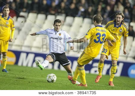 VALENCIA - NOVEMBER 7: #33 Palyakov & Gago during UEFA Champions League match between Valencia CF and FC Bate Borisov, on November 7, 2012, in Mestalla Stadium, Valencia, Spain