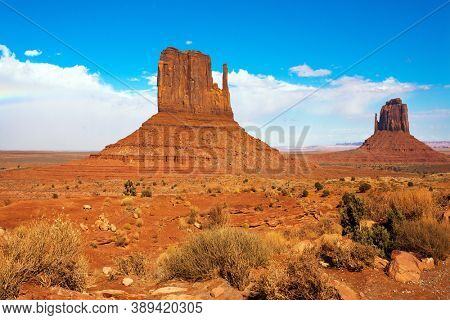 Huge masses of red sandstone - outliers on the Navajo Indian Reservation. The USA. The Mittens. Monument Valley is unique geological formation. The concept of active and photo tourism