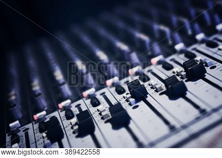 Sound Recording Directors Console. Remote Audio Engineer. Many Buttons Of Grey Audio Mixer Board Con