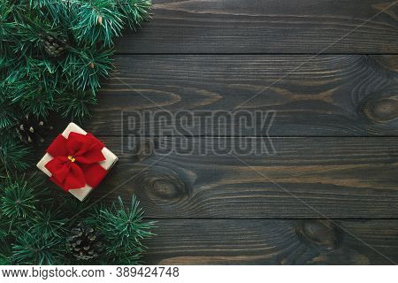 Old Wooden Background With Fir Branches And Gift Box. Christmas Card, Flat Lay, Top View, Copy Space