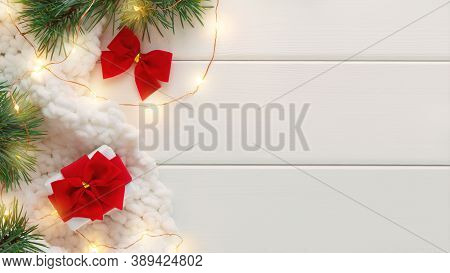 Gift Box, Fir Branches And Christmas Lights On White Wooden Background. Сoncept Of Cozy Holidays. Fl