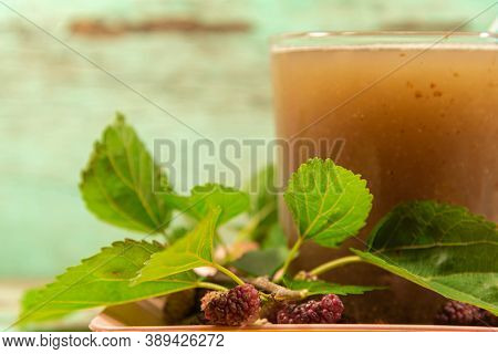 Fruits And Fresh Blackberry Juice On Wooden Construction Background