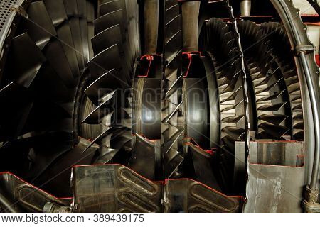 Internal Combustion Rocket Engine In The Section. High Quality Photo