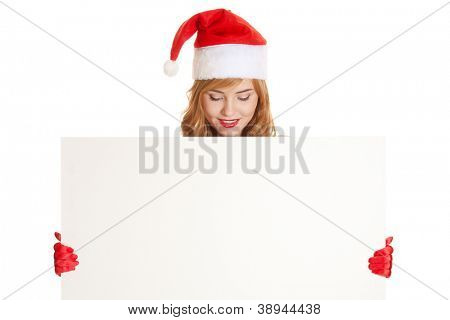 Xmas pretty woman holding blank sign billboard isolated