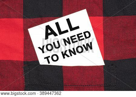 White Business Card With Text All You Need To Know Lies In The Sleeve Of A Checkered Shirt