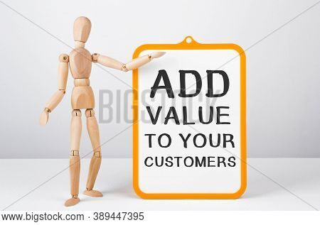 Wooden Man Shows With A Hand To White Board With Text Add Value To Your Customers