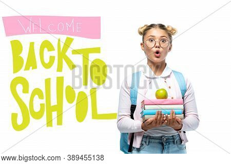 Schoolgirl Holding Apple And Books Near Welcome Back Wo School Lettering On White