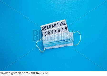 Inscription Covid-19 On Blue Background. Cube With The Inscription. The Inscription Quarantine. The