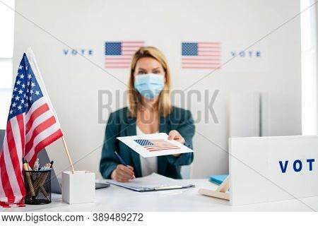Member Of Electoral Commission In Polling Place, Usa Elections And Coronavirus.