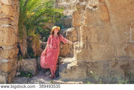 Woman Tourist Among The Ruins Of Anthony Terms, A Building Of The Romans. Carthage Archaeological Si