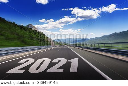 2021 Year. New Two Thousand And Twenty First Year. Figures 2021 On A Suburban Highway. Concept.