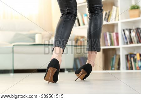 Back View Of A Woman Legs With High Heels Walking And Sprain Ankle