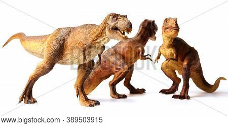 Tyrannosaurus Rex Dinosaurs Toy Isolated On White Background. Closeup Dinosaur And Monster Model .