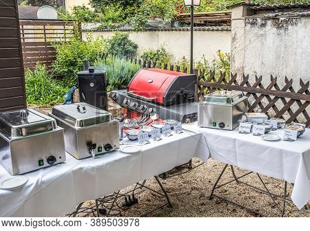 Large Barbecue Grill And Smoker Setup With Sauces Grilling Meat Bbq Party Food Outdoor Garden Party