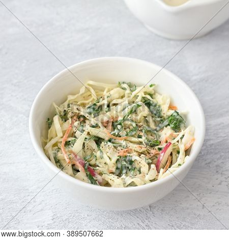 Homemade Healthy Cole Slow Salad With Kale In White Bowl On Gray Textured Background, Top View