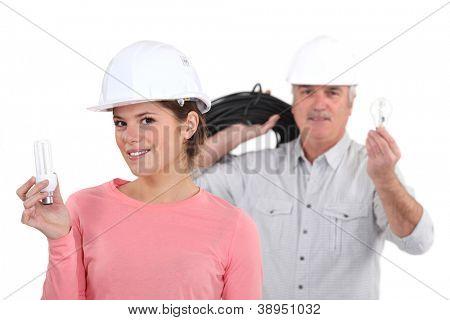 Tradespeople holding lightbulbs