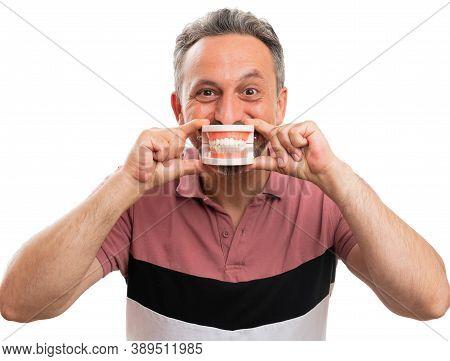 Adult Man Wearing Modern Stylish Summer Attire Presenting Fake Teeth Denture Covering Mouth Making C