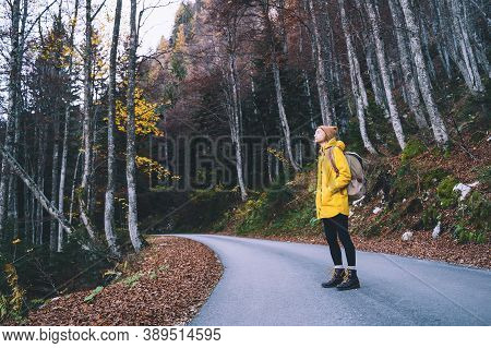 Hiker Woman In Yellow Raincoat In Nature Outdoors.