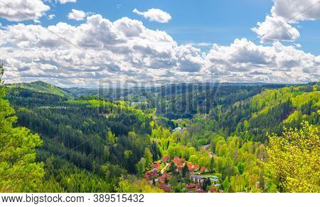 Slavkov Forest Aerial Panoramic View With Small Village, Mountains, Green Hills And Trees Near Karls
