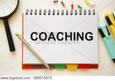 Coaching Text Written On Notepad. From The Very Beginning, The Coach Motivates You For Personal Deve