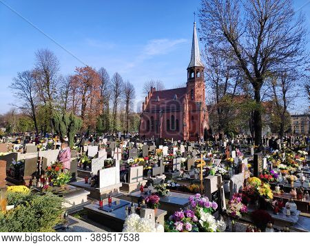 Chorzow, Poland - November 1, 2019: People Visit Graves During All Saints Day In Chorzow. All Saints