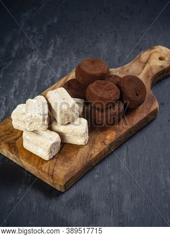 Italian Truffles, Or Tartufi, Resting On A Wood Cutting Board.