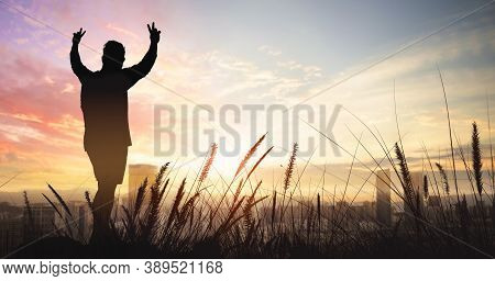 Silhouette Of Man On The Big City With Sunset Sky Background