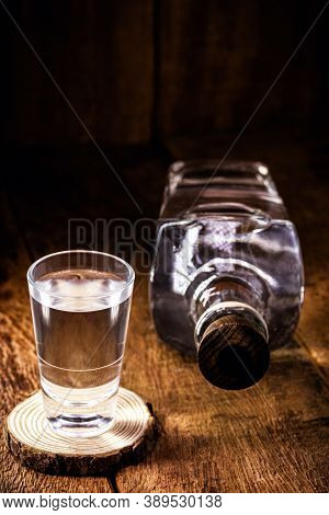 Glass And Bottle Of Strong Distilled Alcohol, Brandy, Sugar Cane-based Drink, Distilled Alcoholic Dr