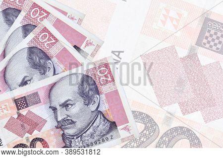 20 Croatian Kuna Bills Lies In Stack On Background Of Big Semi-transparent Banknote. Abstract Busine