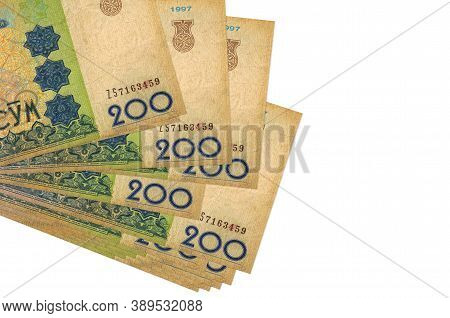 200 Uzbekistani Som Bills Lies In Small Bunch Or Pack Isolated On White. Mockup With Copy Space. Bus