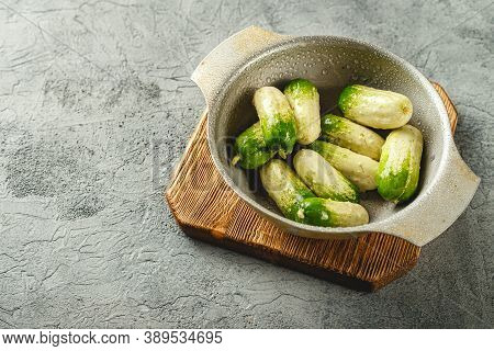 Baby Cucumbers With Unusual Coloring In Metal Bowl On Woooden Cutting Board On Gray Background. Plac