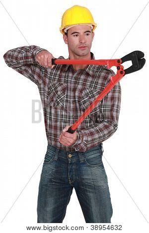Man using bolt-cutters