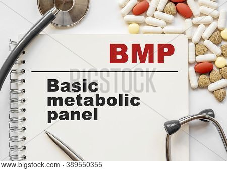 Page In Notebook With Bmp Basic Metabolic Panel On White Background With Stethoscope And Group Of Pi