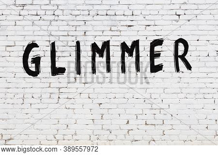 Inscription Glimmer Written With Black Paint On White Brick Wall.