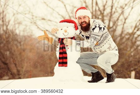 Winter Games. Hipster With Beard Outdoors. Man With Santa Hat Having Fun Outdoors. Guy Happy Face Sn