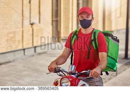 Young Caucasian Male Courier Wearing Protective Face Mask