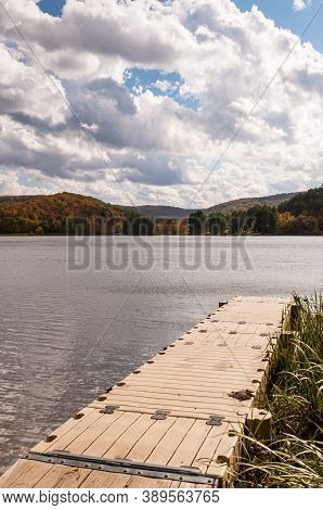 A Floating Boat Dock Into Red House Lake In Cattaraugus County New York, Usa On A Sunny Fall Day