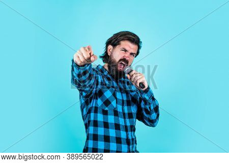Performance On Party. Bearded Hipster Sing A Song In Microphone. Guy With Mic. Concept Of Music. Sin