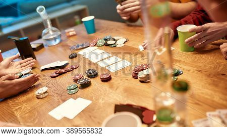 People Playing Poker And Smoking Weed. Poker Chips And Cards, Bong For Smoking Marijuana On The Tabl