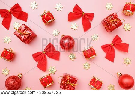 Christmas Greating Card Composition. Christmas Red And Golden Decorations With On Pink Background. F
