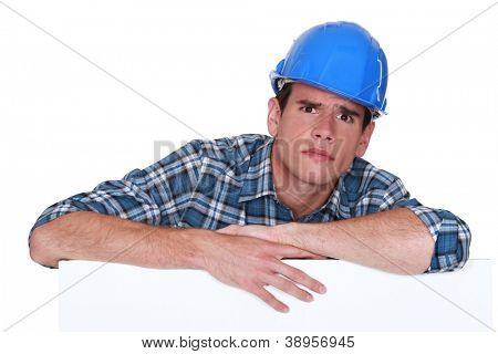 A glaring tradesman