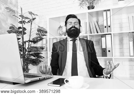 Modern Lounge Music Vibes. Manager Sit With Mudra Gesture. Bearded Man Relax In Modern Office. Moder