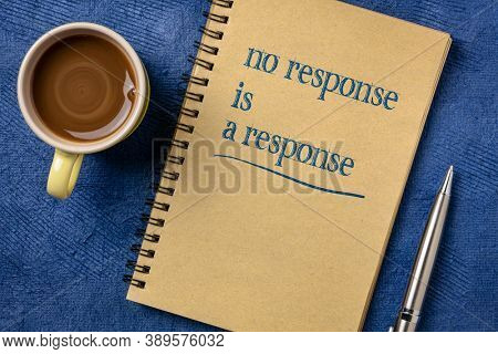 no response is a response note in a spiral notebook with a cup of coffee - answer, reply and communication concept