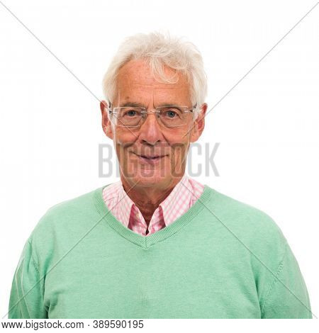 Senior man in green sweater isolated over white background