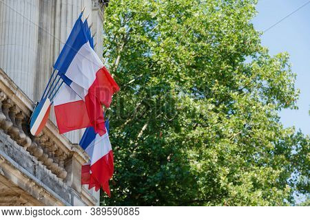 Lille, France - July 19, 2013. Real French Flags Waving. France National Flags Outside A Historic Bu
