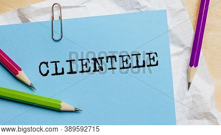 Clientele Text Written On A Paper With Pencils In Office