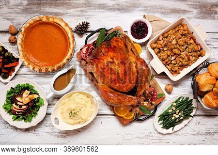 Classic Thanksgiving Turkey Dinner. Overhead View Table Scene On A Rustic White Wood Background. Tur